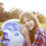 Girl embracing globe